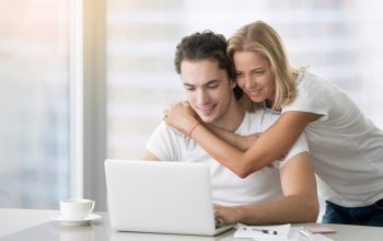 young-happy-couple-with-laptop.jpg